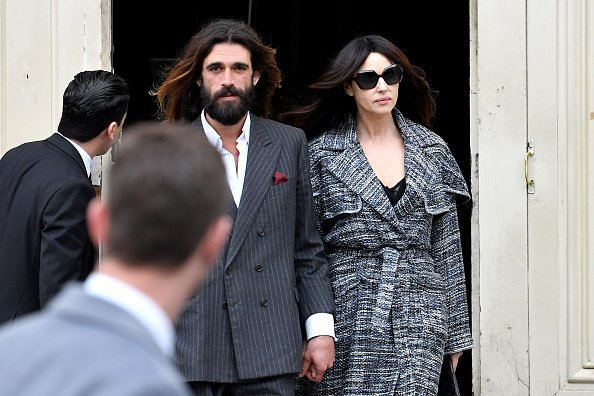 Nicolas Lefebvre and Monica Bellucci holding hands at the Chanel show | Photo: Getty Images