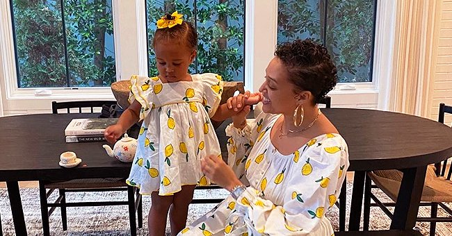 Tia Mowry's Baby Girl Cairo Is Dressed in White Tulle Skirt with Bow in a Throwback Photo