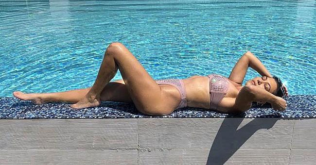 Kourtney Kardashian Flaunts Her Curves in a Shimmering Bikini