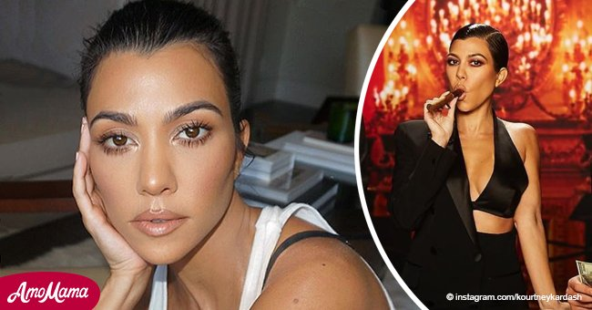 Kourtney Kardashian flaunts cleavage in a silk bra, covering half her body in an elegant suit
