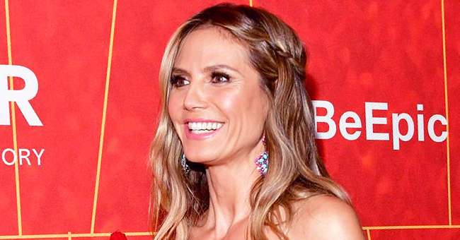 Heidi Klum Shows off Her Toned Figure and Makeup-Free Face in Red Lacy Underwear in Tokyo