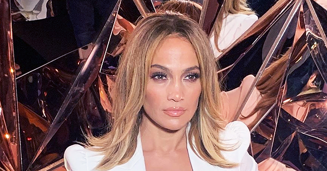 'Hustlers' Actress Jennifer Lopez Dazzles in Blazer with Deep Neckline and Tight White Skirt