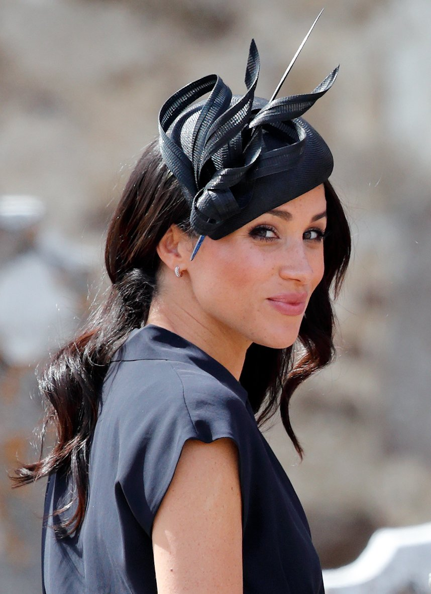 Meghan Markle attends the wedding of Charlie van Straubenzee and Daisy Jenks on August 4, 2018, in Frensham, England. | Source: Getty Images.