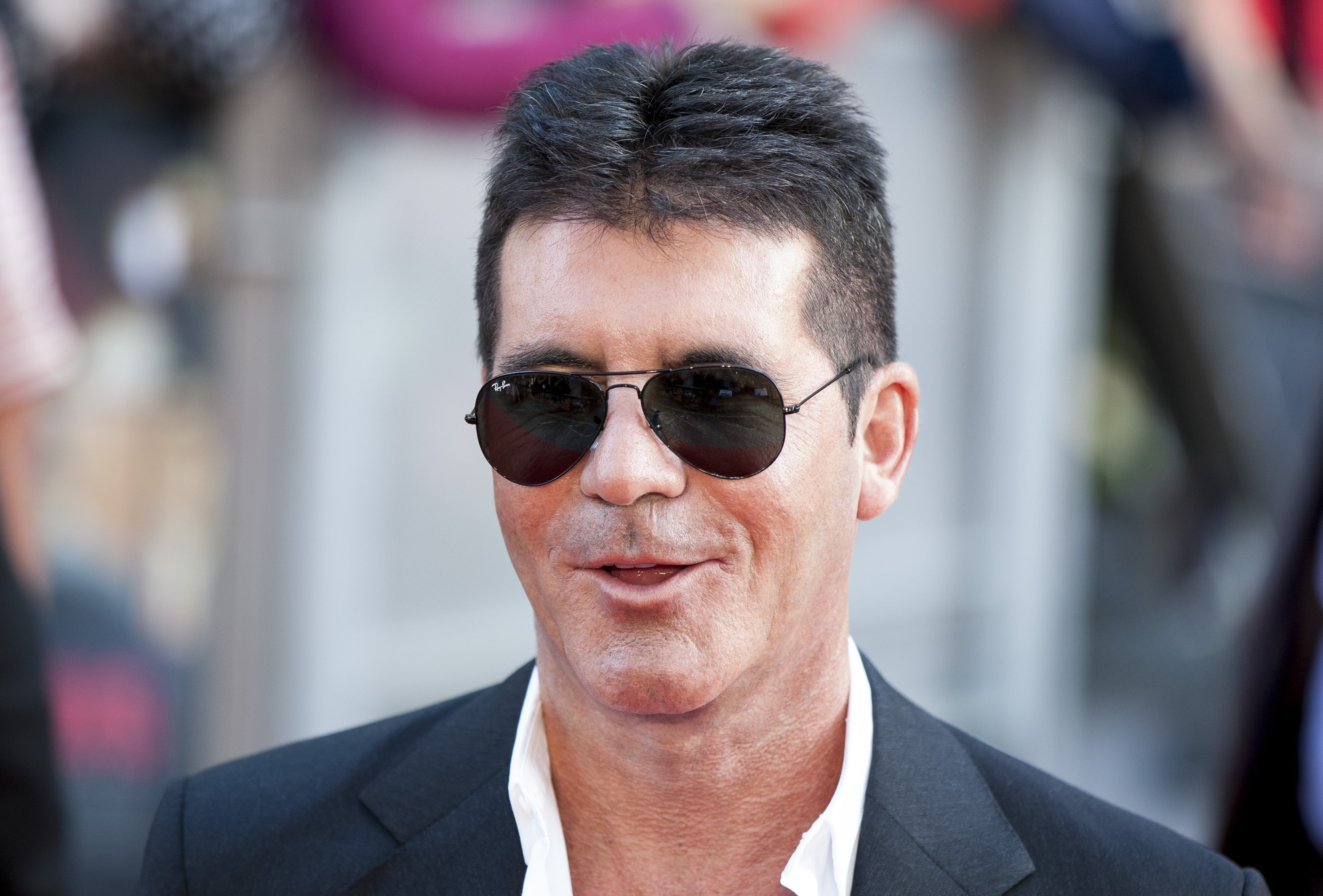 "Simon Cowell at the world premiere of ""One Direction: This is Us"" in August 2013. 
