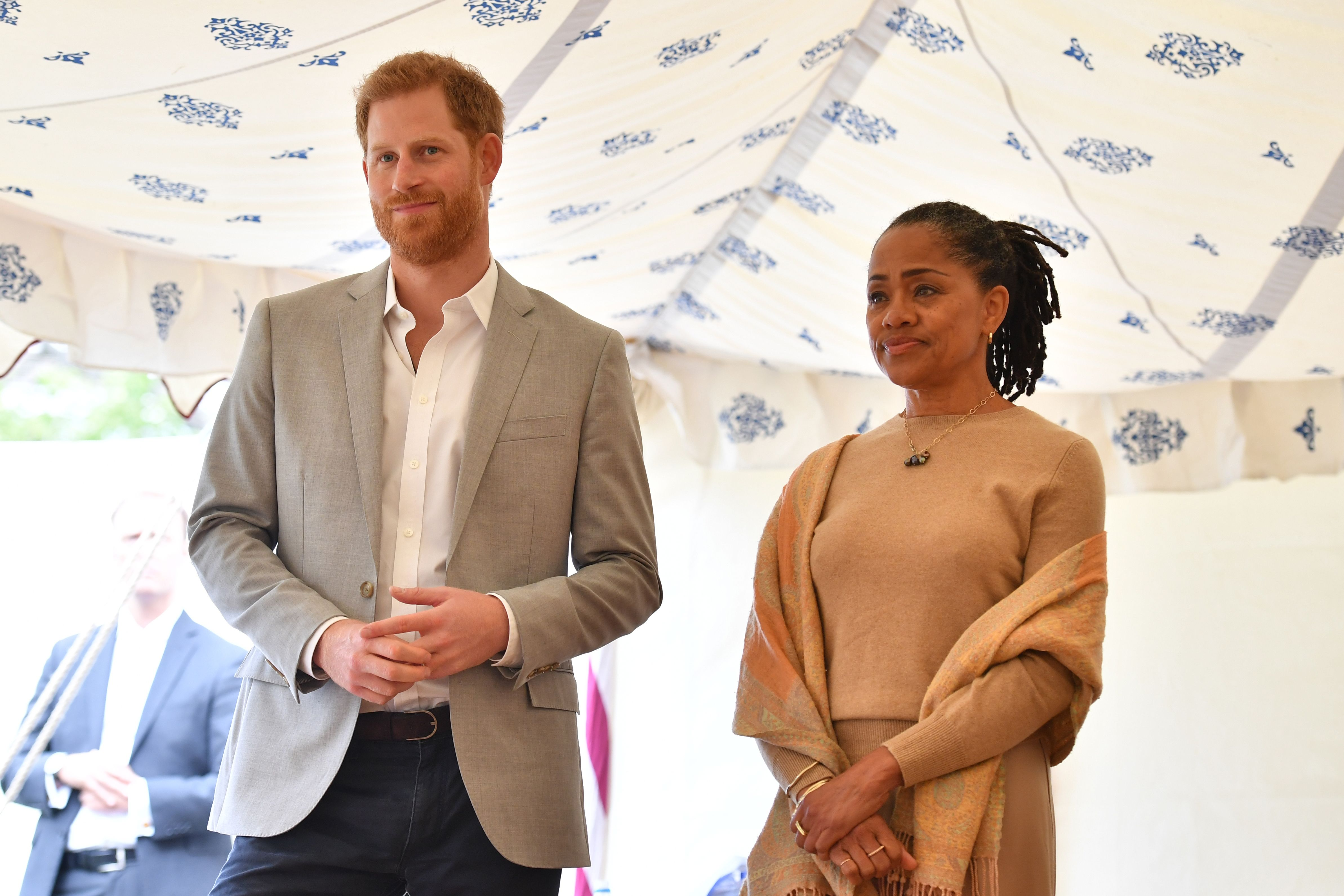 Prince Harry, Duke of Sussex and Doria Ragland listen to Meghan, Duchess of Sussex at Kensington Palace on September 20, 2018 | Getty Images