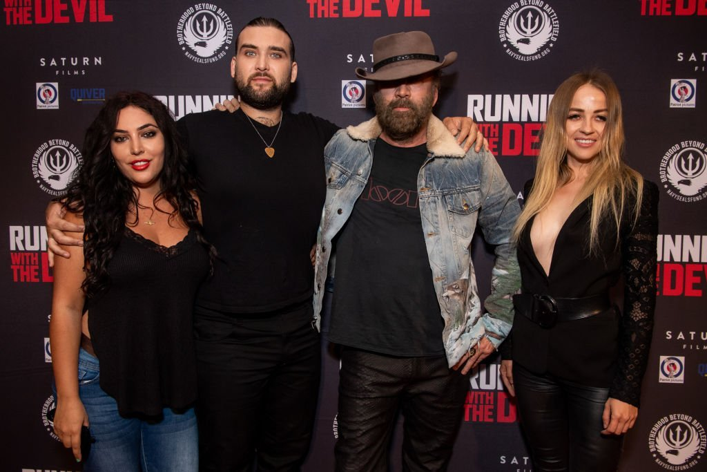 Hila Aronian, Weston Cage, Nicolas Cage, and Erika Koike attend the premiere of Quiver Distribution's 'Running with the Devil' at Writers Guild Theater | Getty Images