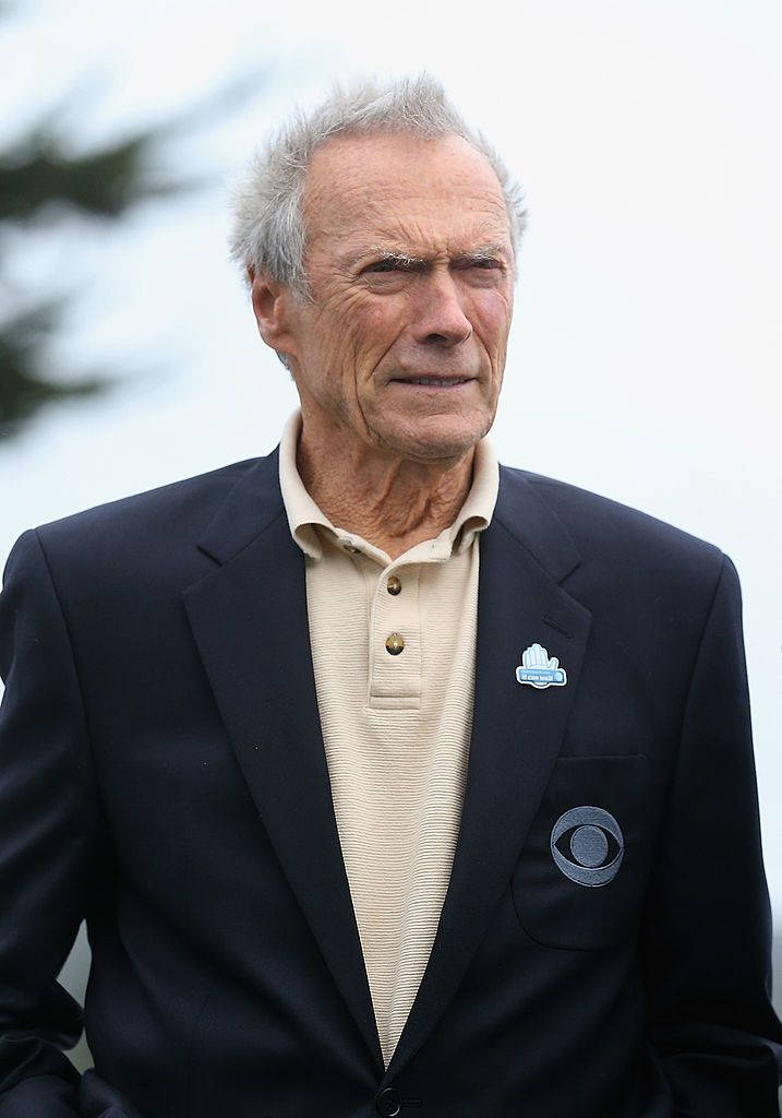 Clint Eastwood stands on the 18th green during the final round of the AT&T Pebble Beach National Pro-Am at the Pebble Beach Golf Links on February 9, 2014 in Pebble Beach, California. | Source: Getty Images