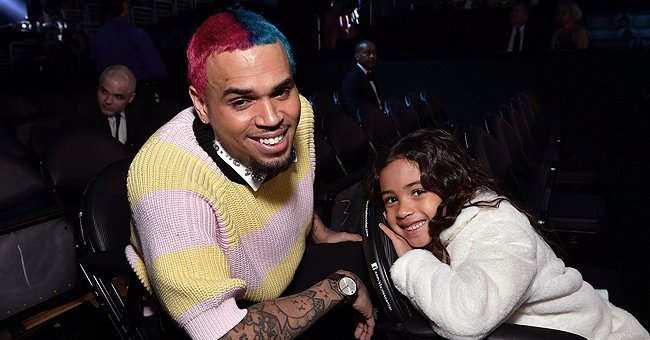 See Chris Brown's Daughter Royalty as She Bravely Touches Gigantic Rainbow Python in a Cool Pic
