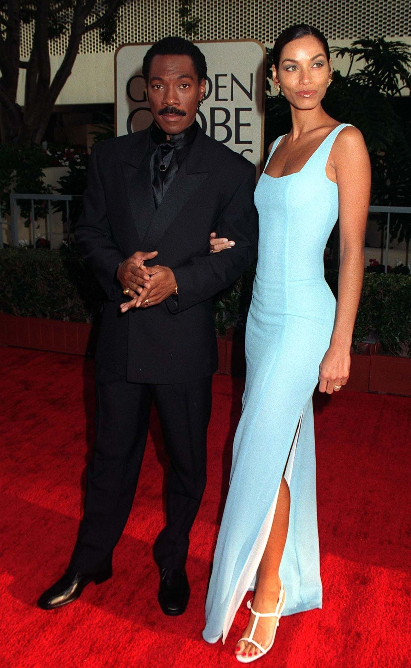 L'acteur EDDIE MURPHY & son épouse NICOLE aux Golden Globe Awards. | Photo : Shutterstock