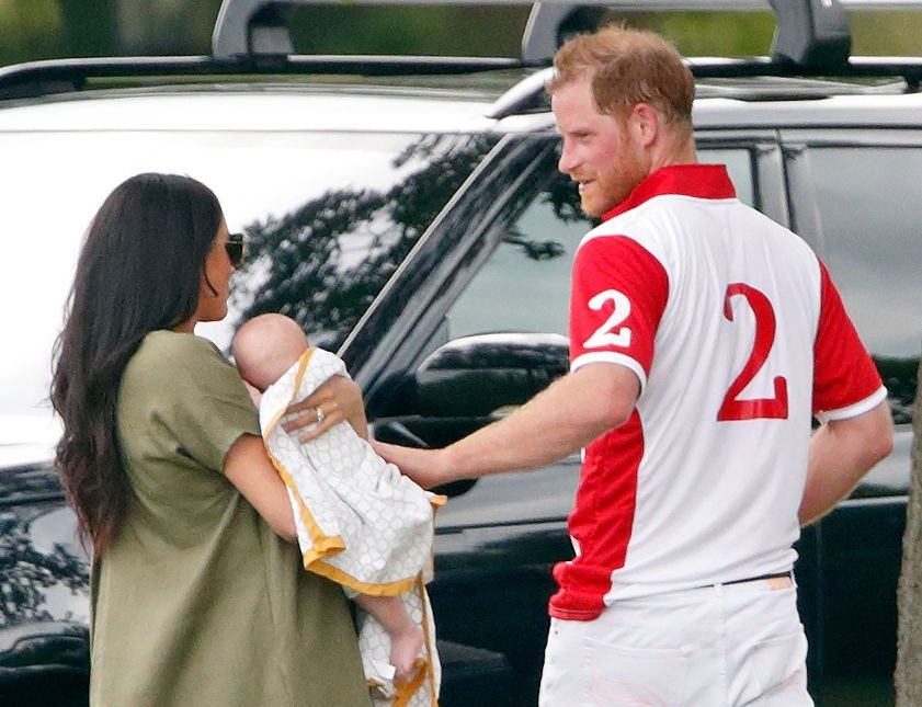 Meghan, Duchess of Sussex, Archie Harrison Mountbatten-Windsor and Prince Harry, Duke of Sussex attend the King Power Royal Charity Polo Match in Wokingham, England | Photo: Getty Images