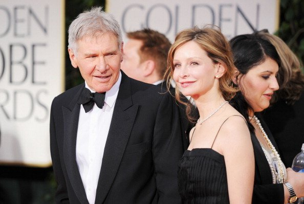 Harrison Ford and Calista Flockhart arrive at the 69th Annual Golden Globe Awards held at the Beverly Hilton Hotel | Photo: Getty Images