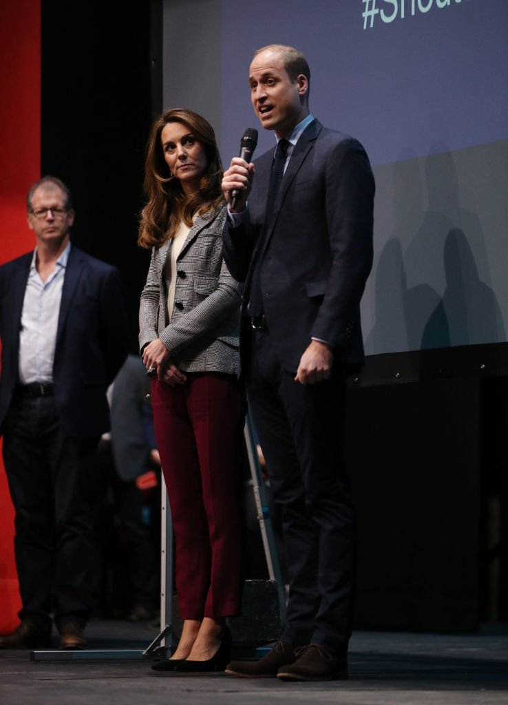 Prince William, Duke of Cambridge gives a speech next to Catherine, Duchess of Cambridge as they attend Shout's Crisis Volunteer celebration event at Troubadour White City Theatre | Photo: Getty Images