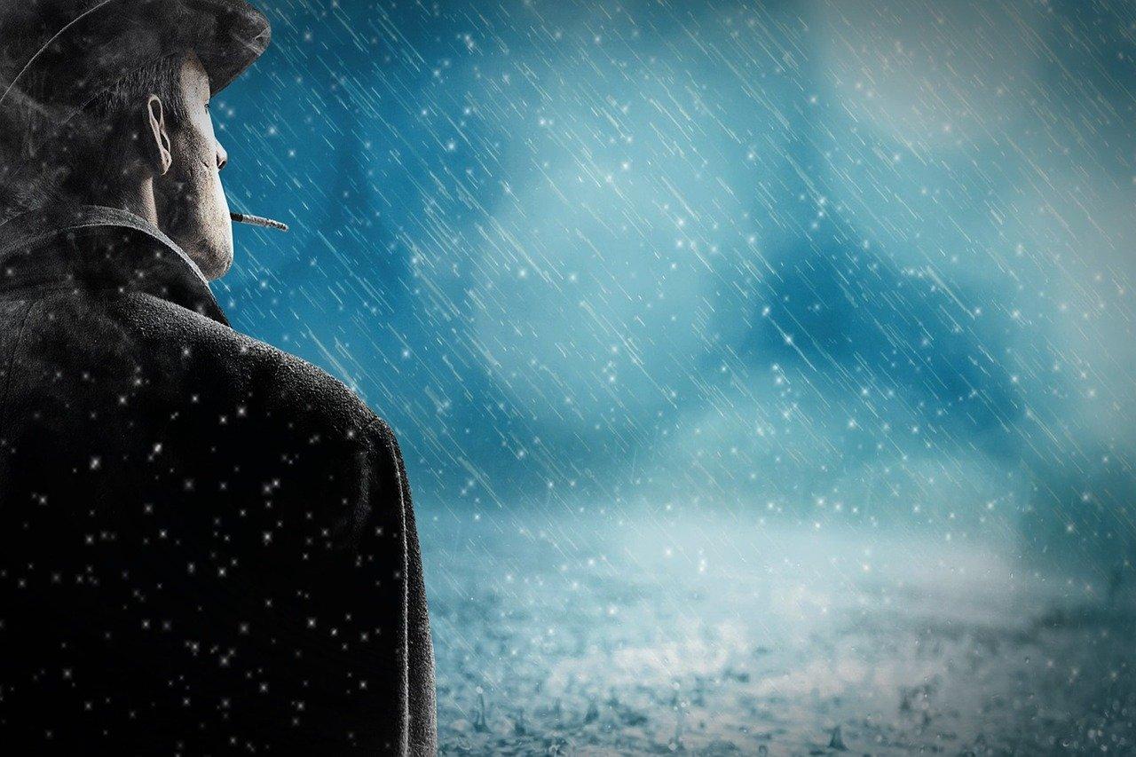 Rauchender Mann im Regen - Quelle: Pixabay
