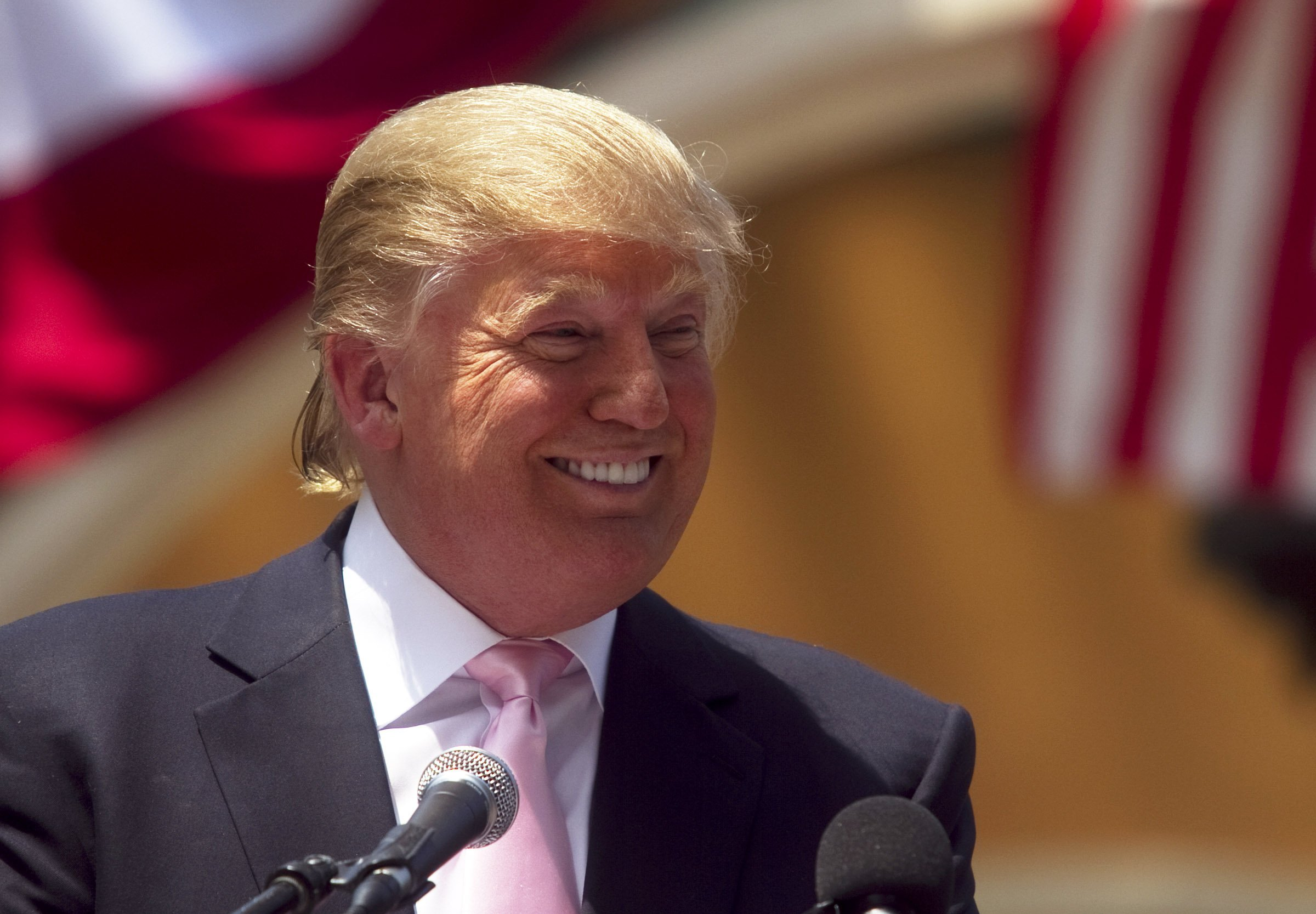 Donald Trump laughs while speaking to a crowd at the 2011 Palm Beach County Tax Day Tea Party on April 16, 2011, at Sanborn Square in Boca Raton, Florida. | Source: Getty Images.