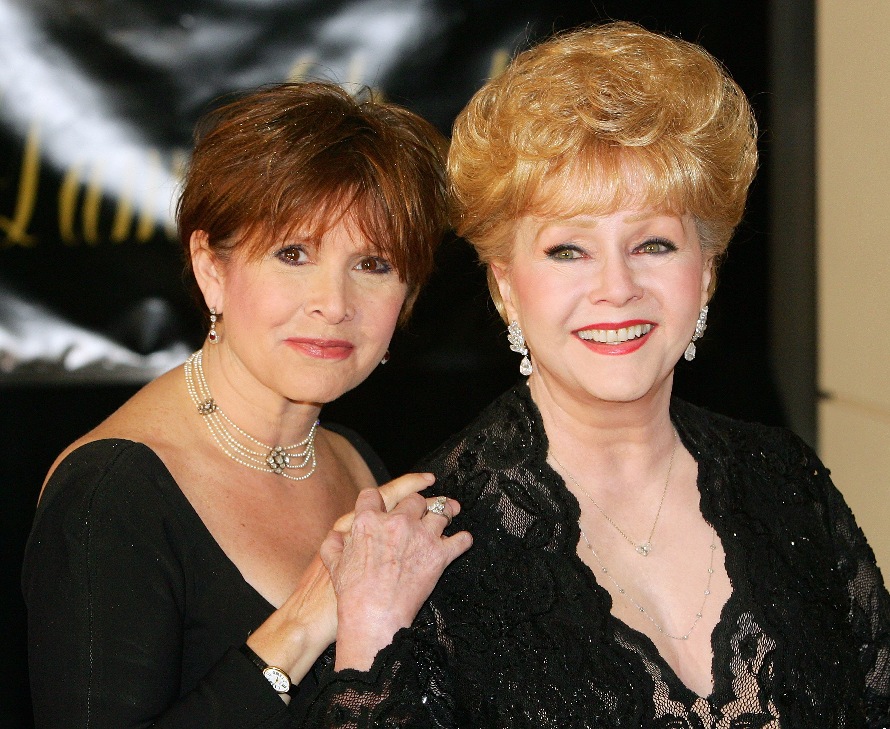 Actress Carrie Fisher and her mother, actress Debbie Reynolds, at Dame Elizabeth Taylor's 75th birthday party at the Ritz-Carlton, Lake Las Vegas on February 27, 2007 | Photo: Getty Images