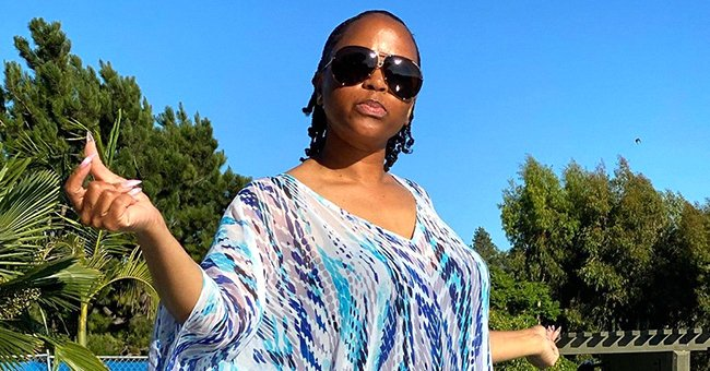 Snoop Dogg's Wife Shante Enjoys the Summer Heat in a Colorful Dress in New Poolside Photos