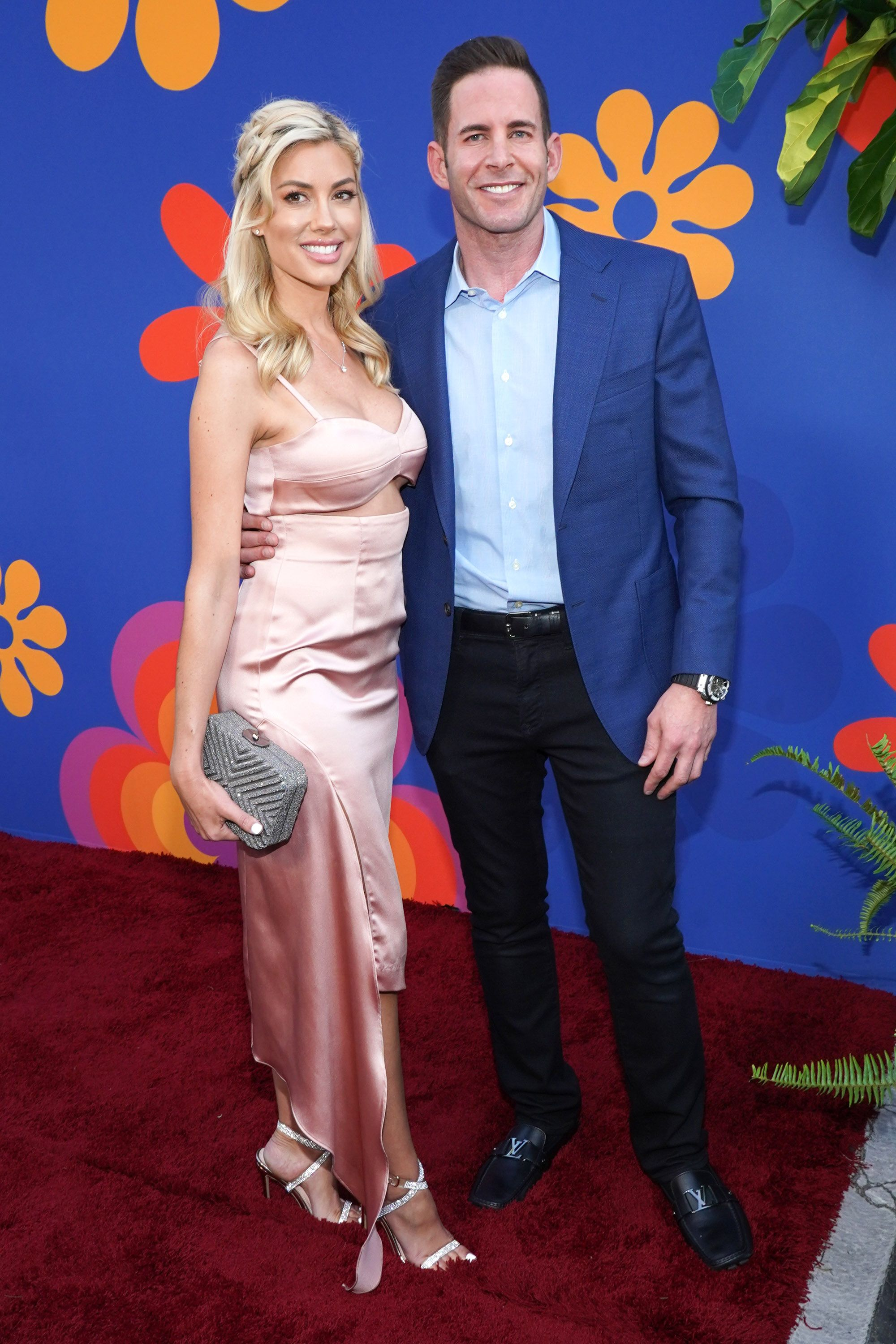 """Tarek El Moussa and Heather Rae Young at the premiere of HGTV's """"A Very Brady Renovation"""" in 2019, in North Hollywood 