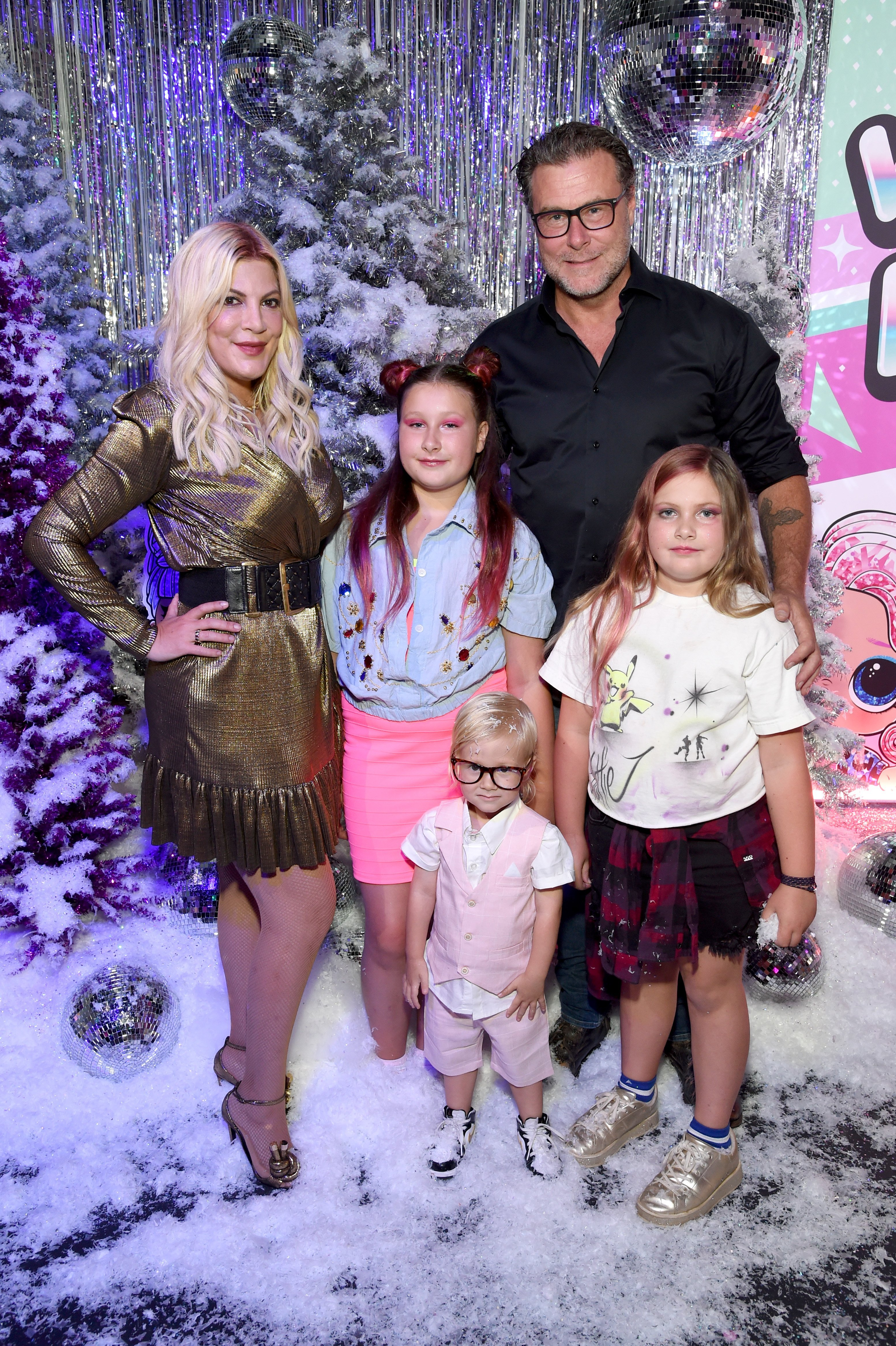 Tori Spelling and Dean McDermot with three of their kids attend L.O.L. Surprise! Winter Disco Launch Party in Los Angeles, California on September 27, 2019 | Photo: Getty Images