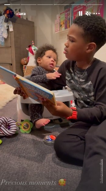 A picture of Future Zahir reading a book to his brother, Win.   Photo: Instagram/Ciara