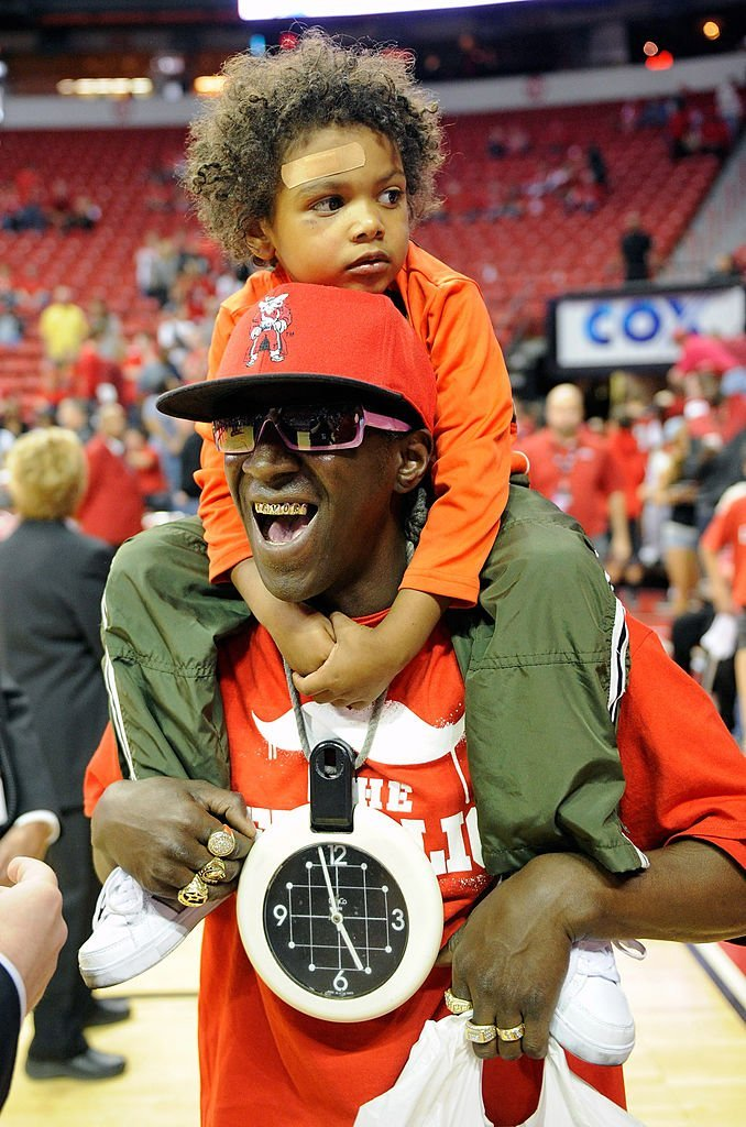 Flavor Flav with one of his sons, Karma Drayton at a game in Las Vegas in February 2012. | Photo: Getty Images