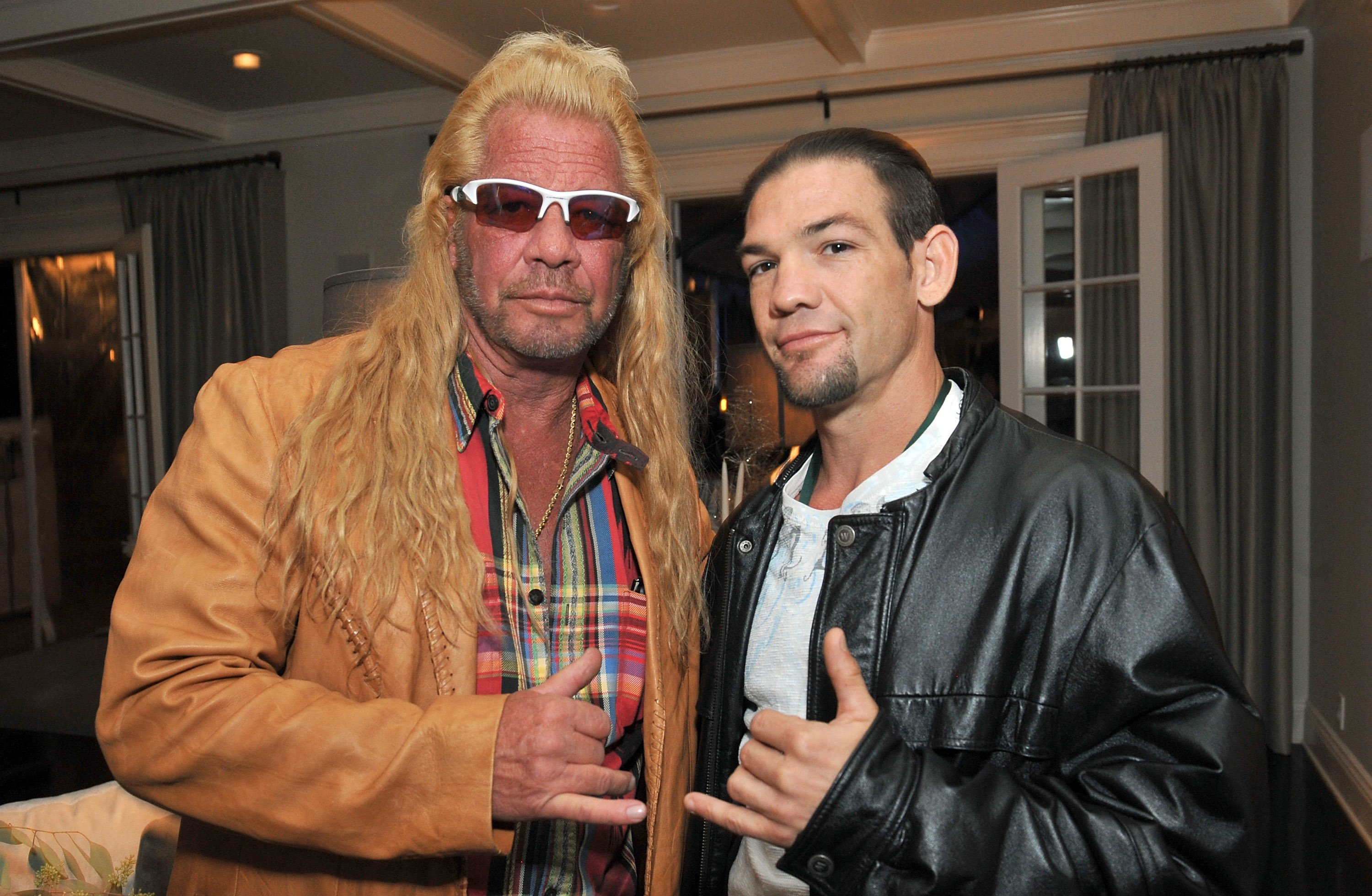 Dog Chapman and Leland Chapman attend the 2013 Electus & College Humor Holiday Party on December 12, 2013, in Los Angeles, California. | Source: Getty Images.