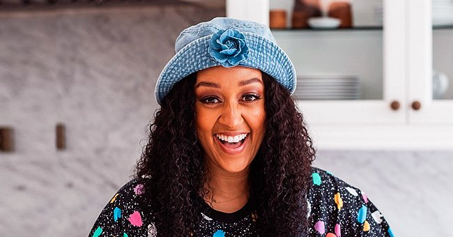 Tia Mowry from 'Sister, Sister' Steals Hearts with Cute Photo of Daughter Cairo Smiling in White Dress & Matching Giant Bow
