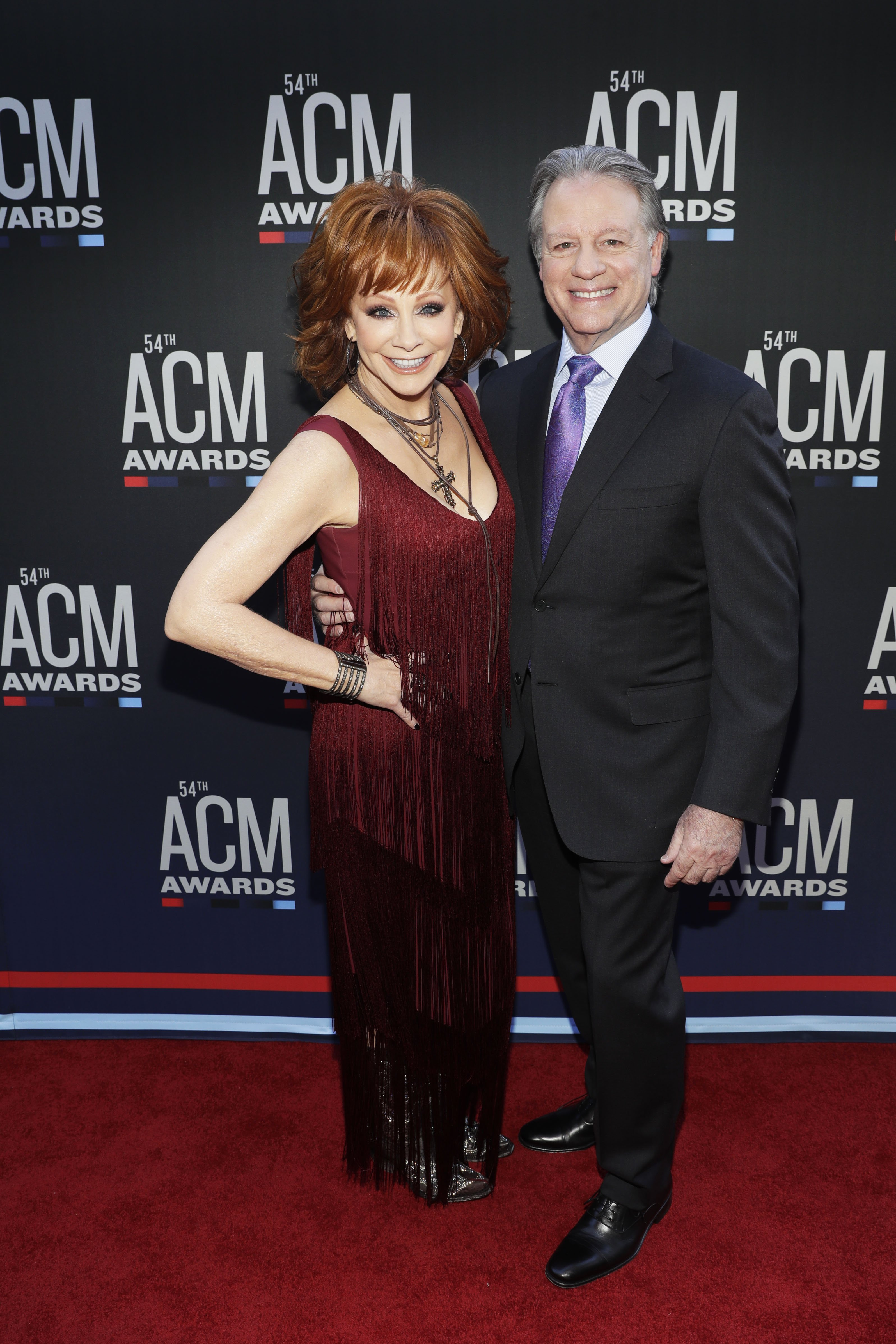 """Reba McEntire and Anthony """"Skeeter"""" Lasuzzo attend the 54th Academy Of Country Music Awards on April 07, 2019 ,in Las Vegas, Nevada.   Source: Getty Images."""