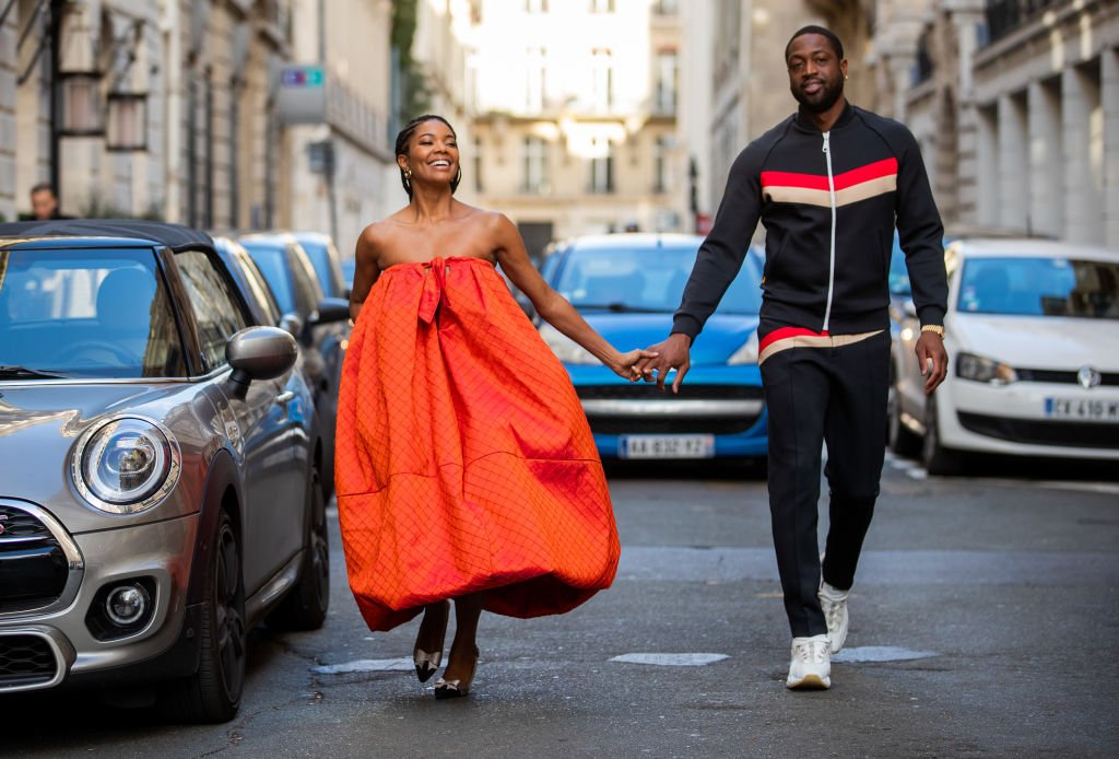 Gabrielle Union walks hand in hand with her husband Dwyane Wade during Paris Fashion Week on January 19, 2020, in Paris, France | Source: Christian Vierig/Getty Images