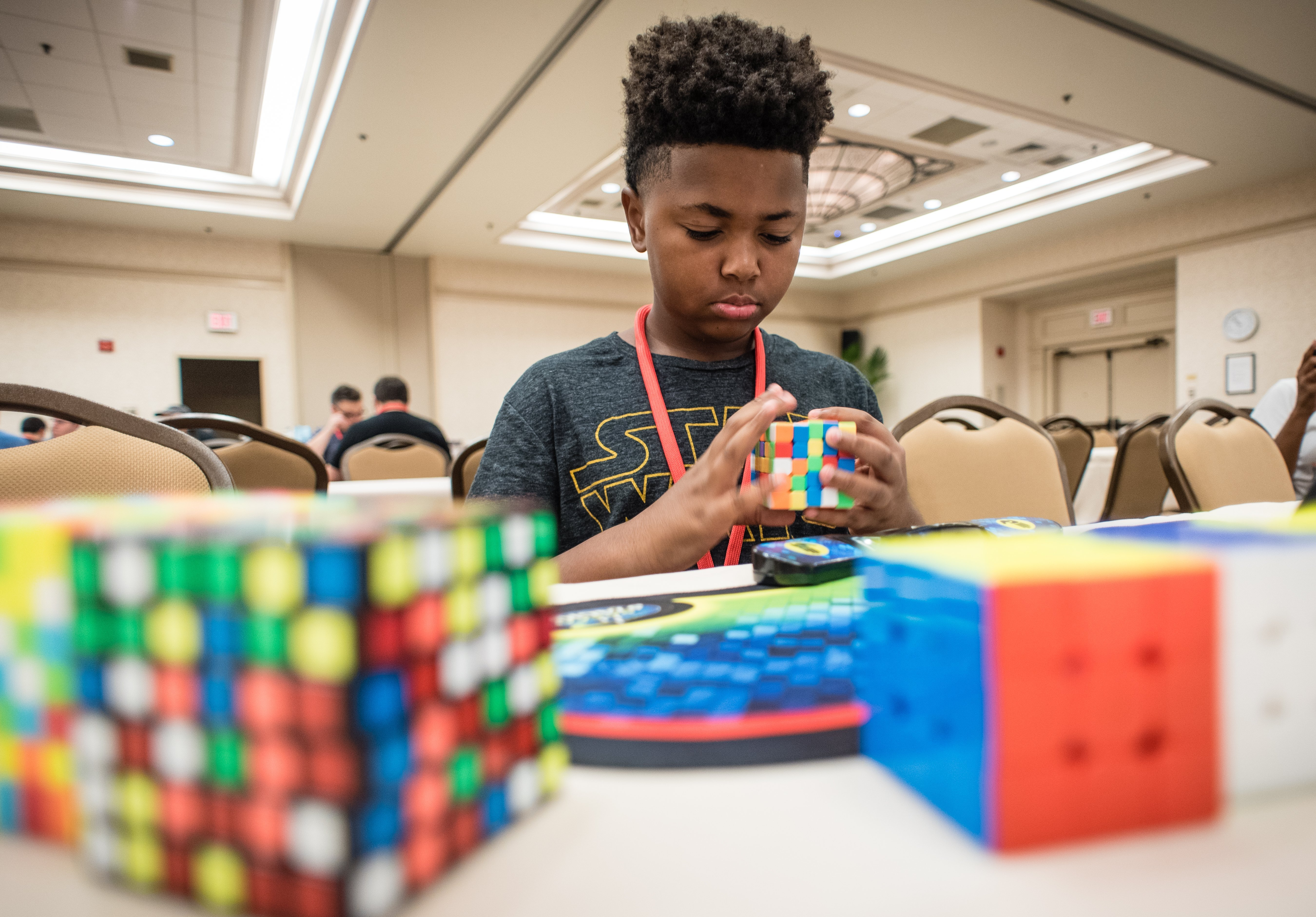 Stone Simpson, 11, from DC, came to demonstrate and teach people how to solve Rubik's Cubes and other twisty puzzles.|Photo: Getty Images