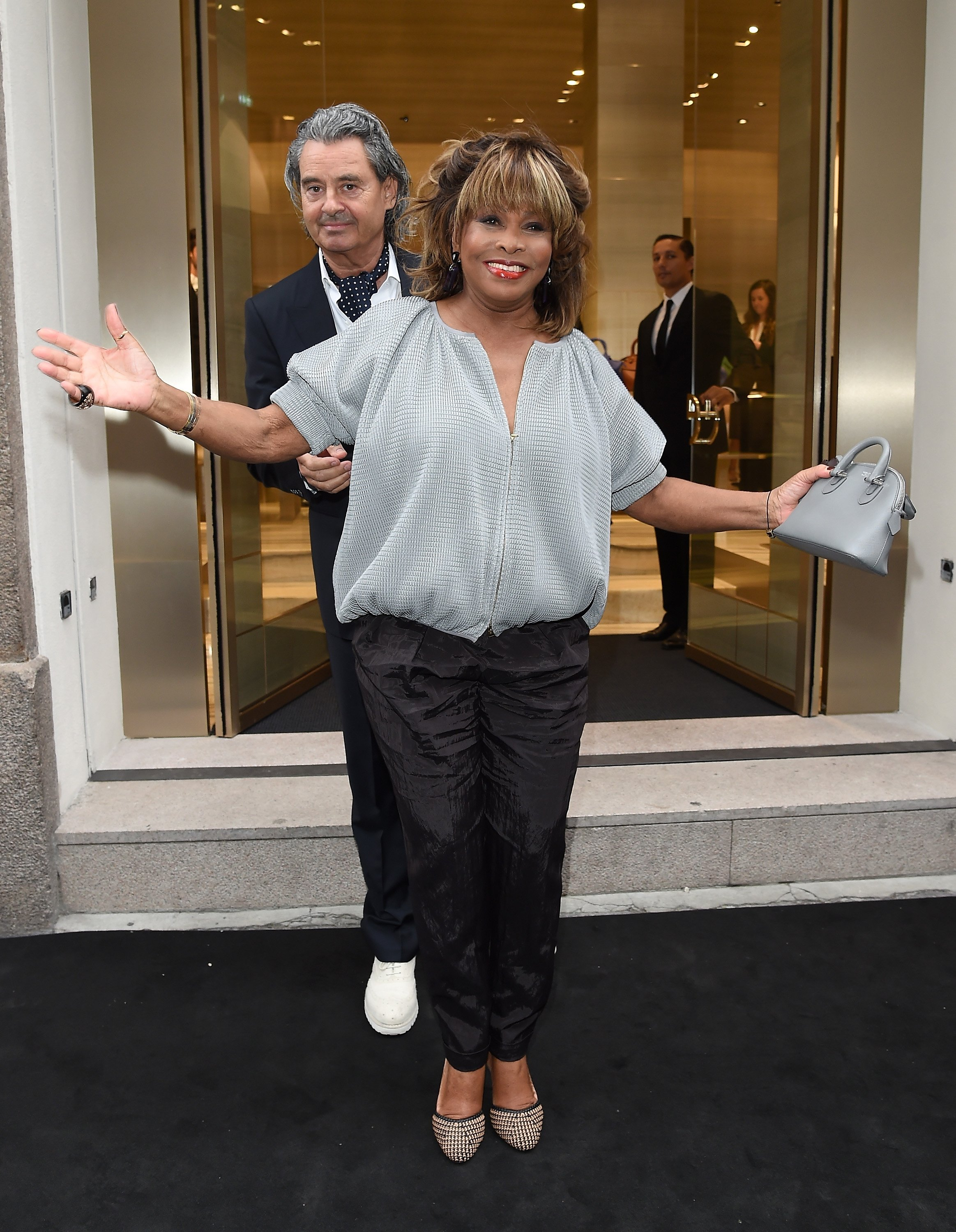 Tina Turner and Erwin Bach attend the Giorgio Armani 40th Anniversary Boutique Cocktail Reception on April 29, 2015 in Milan, Italy. | Source: Getty Images