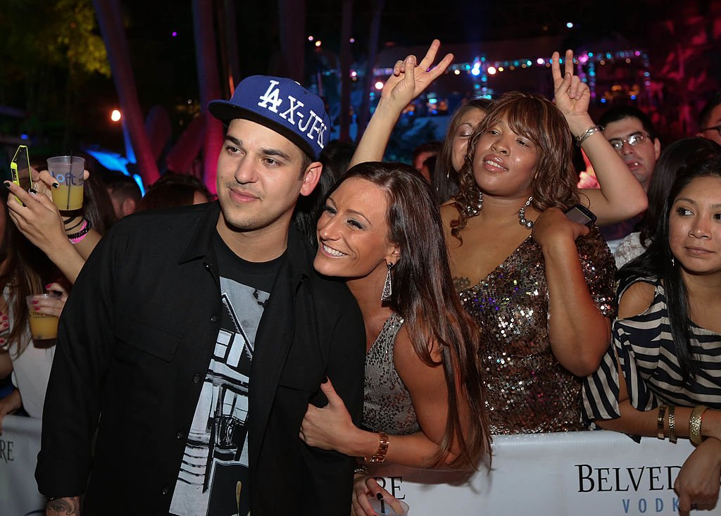 Rob Kardashian poses with fans while hosting The Pool After Dark at Harrah's Resort, September 2012 | Source: Getty Images
