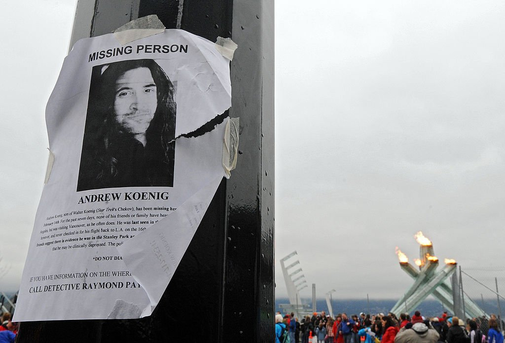 A missing persons poster for actor Andrew Koenig is seen on a light pole in front of the Olympic Cauldron | Getty Images
