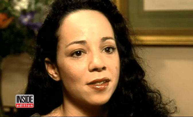 Mariah Carey's sister, Alison Carey in an interview in the '90s | Source: YouTube/InsideEdition