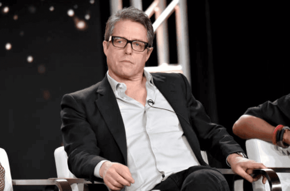Hugh Grant sits onstage for a question and answer session during the Winter Television Critics Association Press Tour, on January 15, 2020, in Pasadena, California | Source: Jeff Kravitz/Getty Images for WarnerMedia