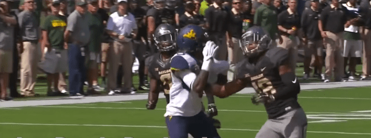 Chance Waz preventing a touchdown playing for Baylor University | Photo: YouTube/JustBombsProductions