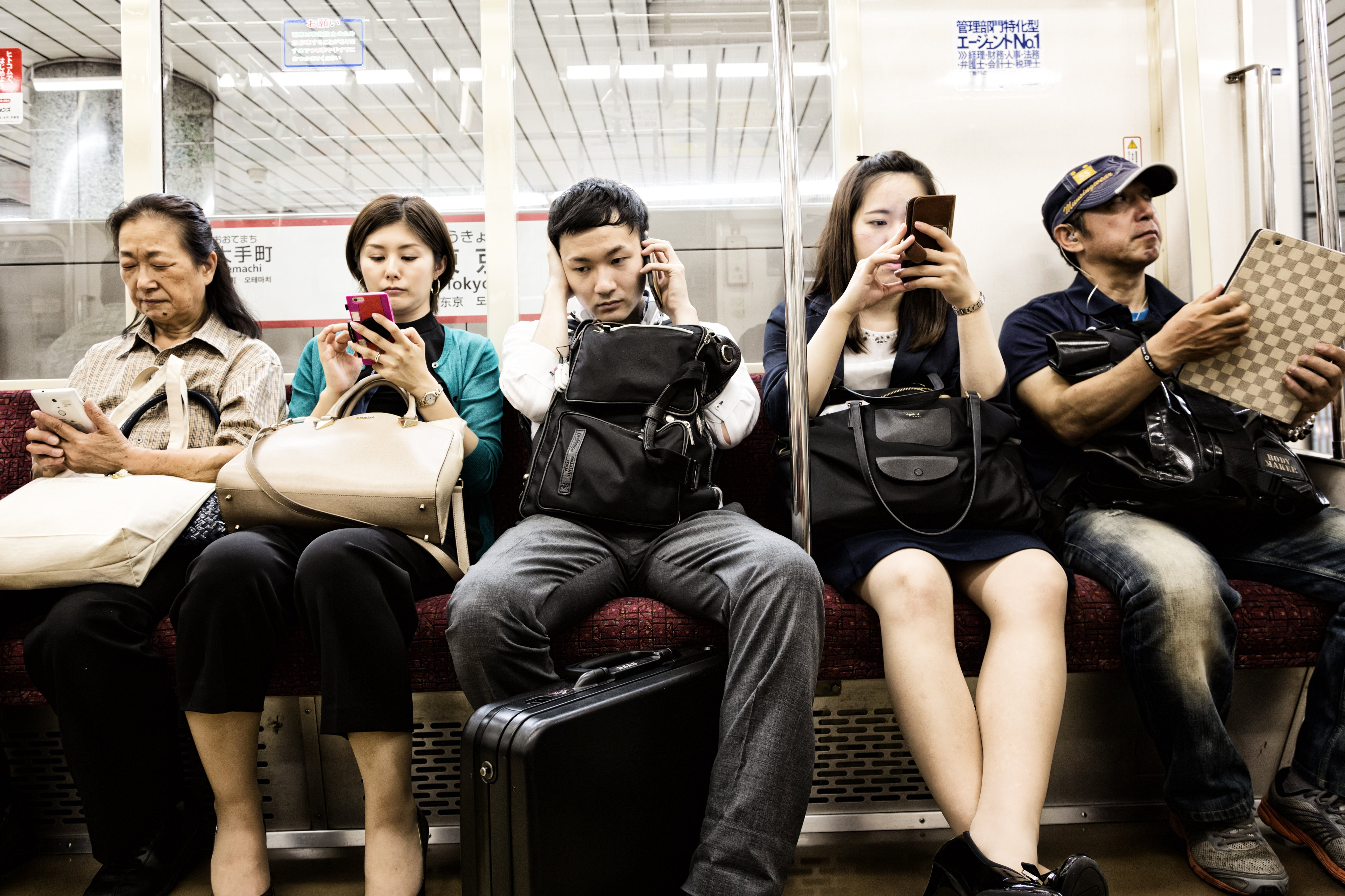 People sit in a bus | Photo: Shutterstock