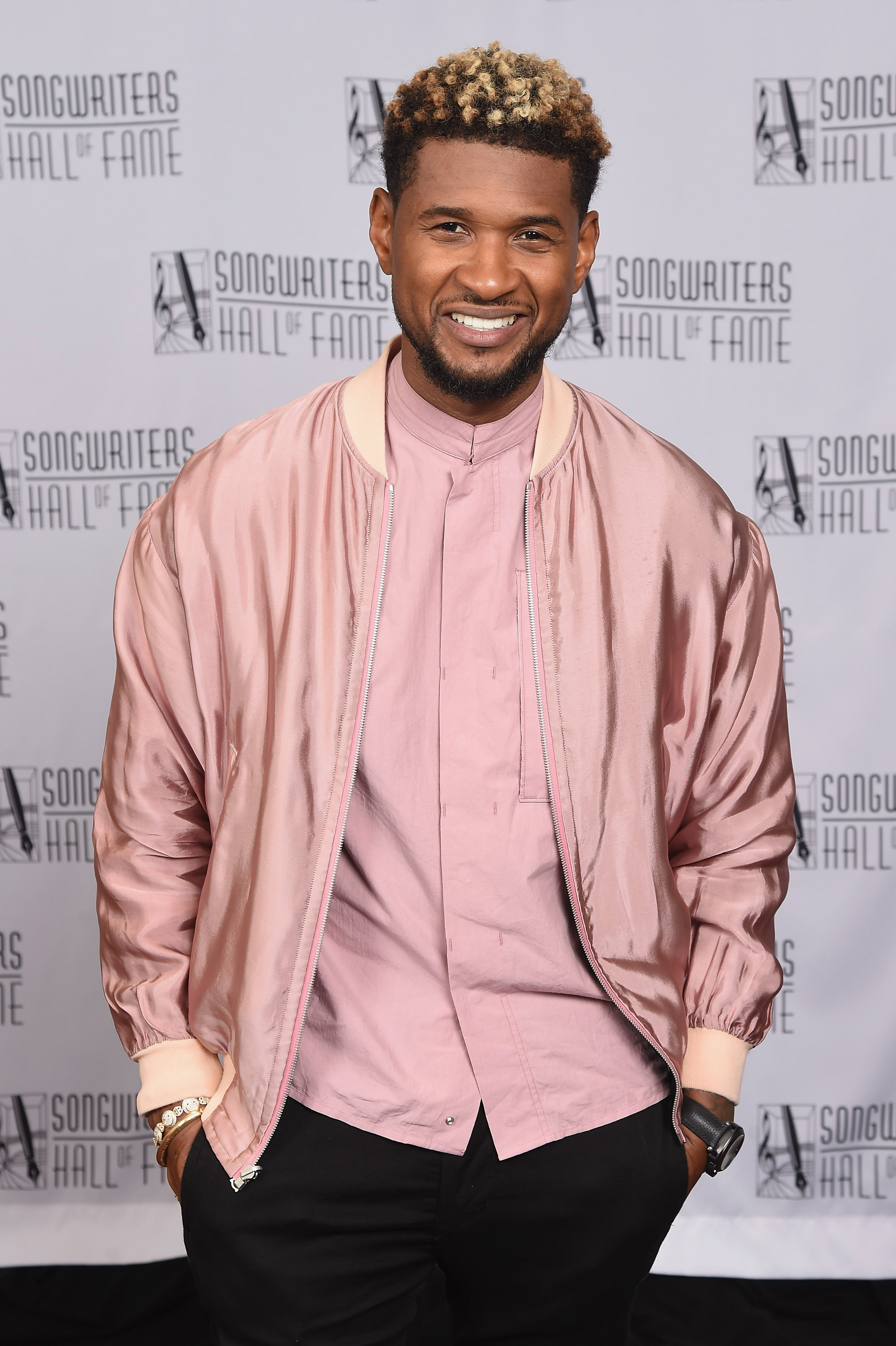 Usher posing backstage at the Songwriters Hall of Fame induction in June 2017.   Photo: Getty Images