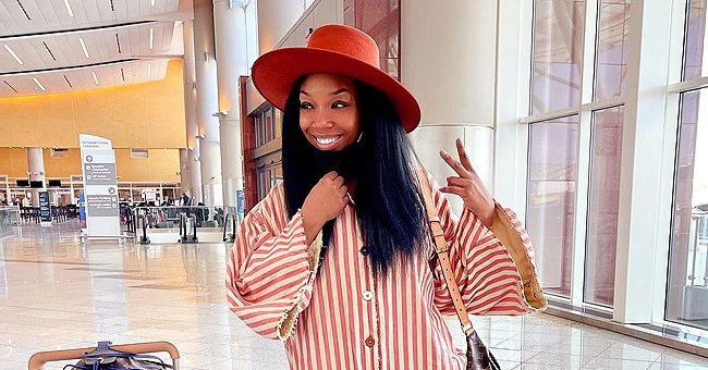 Brandy Looks Stunning Styled with Straight Hair in a Long Striped Dress & Sneakers (Photos)