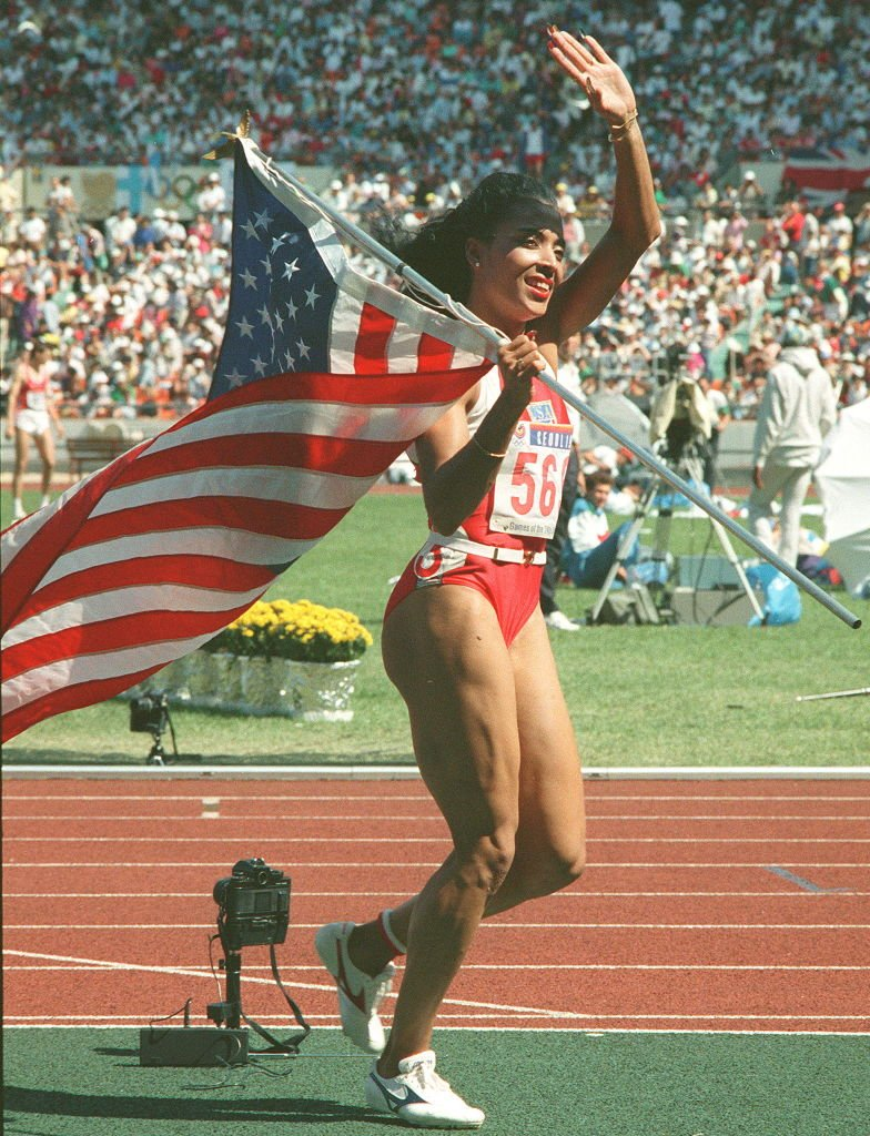 Florence Griffith-Joyner walks with the U.S flag at the Summer Olympic Games in Seoul, South Korea, on September 25, 1988   Photo: Getty Images