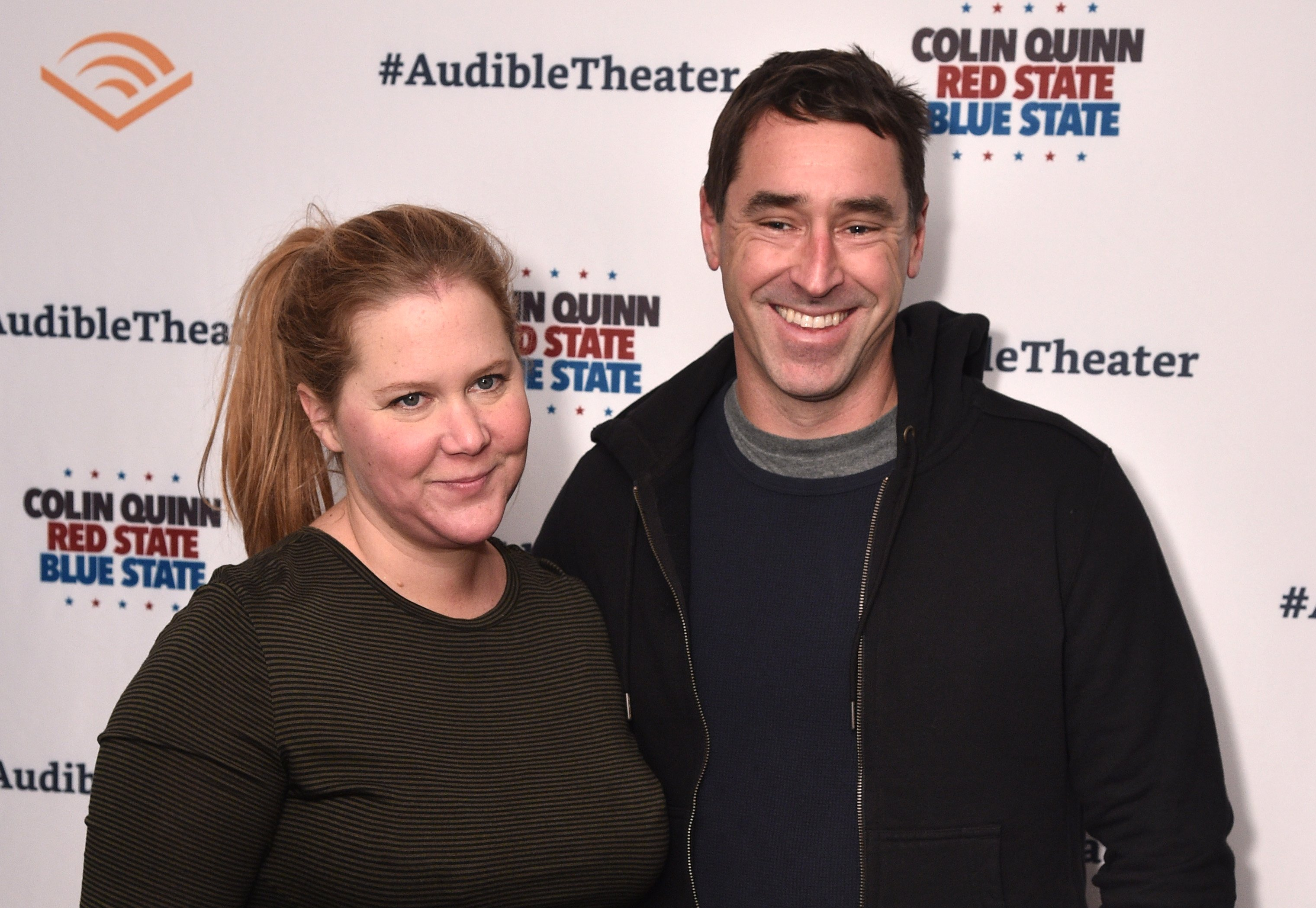 "Amy Schumer and Chris Fischer attend the Opening Night for Colin Quinn's ""Red State Blue State"" at Audible's Minetta Lane Theatre in NYC  on January 22, 2019. 