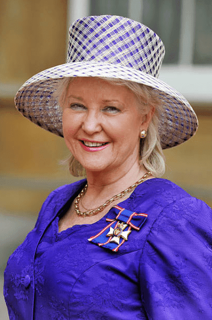 Angela Kelly wears her Royal Victorian Order medal, presented to her by Queen Elizabeth at the Investiture ceremony at Buckingham Palace, on November 16, 2012, in London, England | Source: John Stillwell - WPA Pool /Getty Images