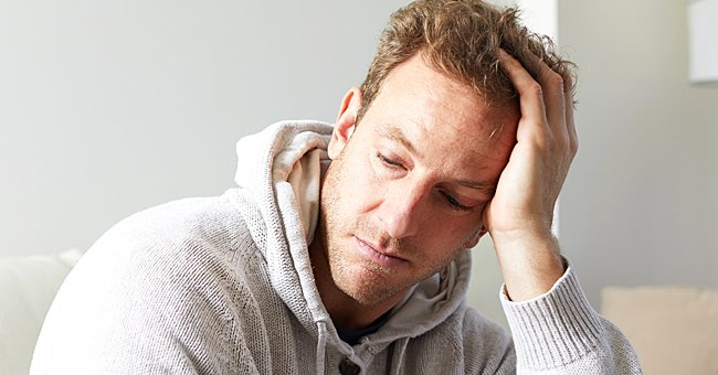 A photo of a frustrated man looking into the distance. | Photo: Shutterstock