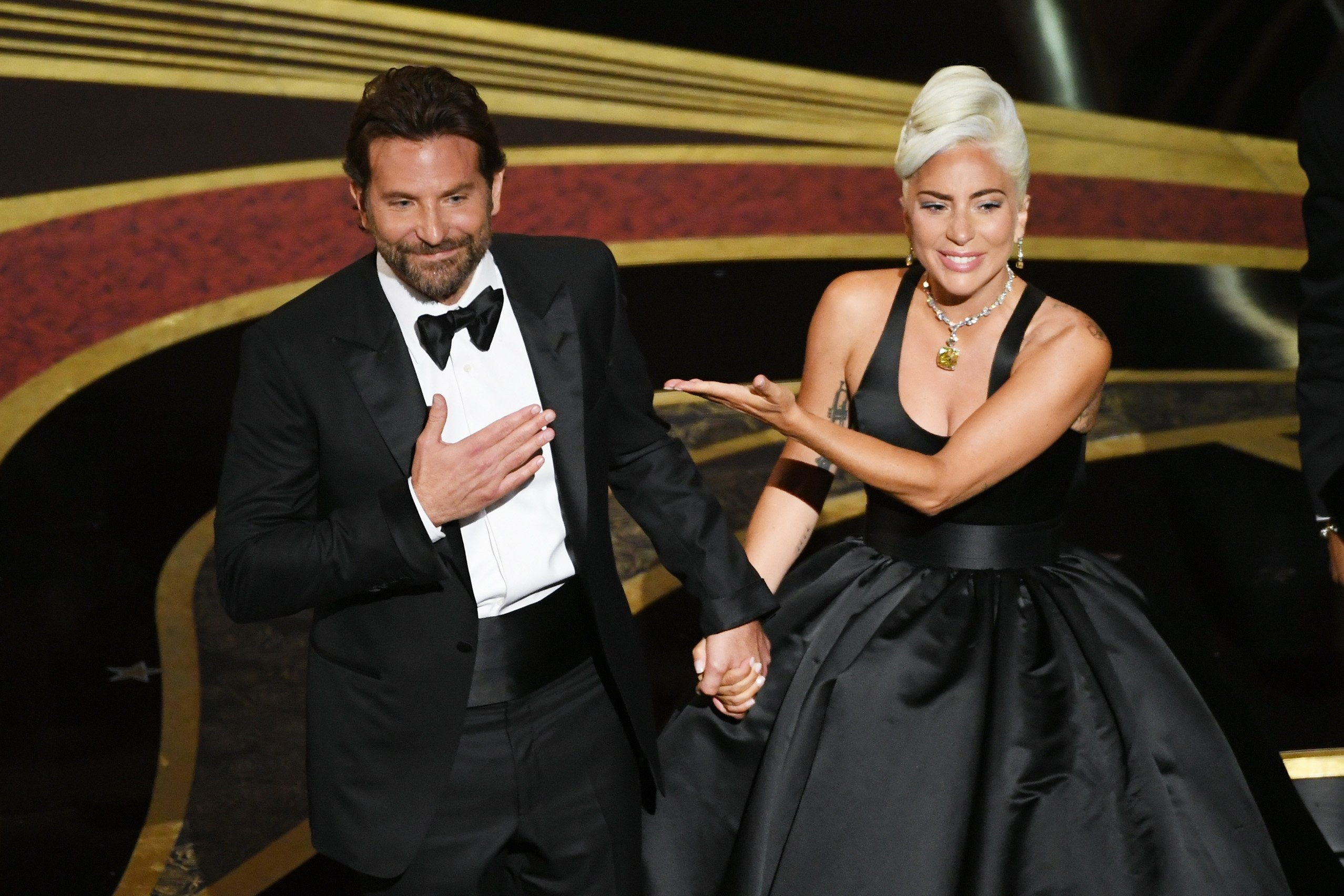 Lady Gaga and Bradley Cooper addressing the audience after their performanc at the Academy Awards | Photo: Getty Images