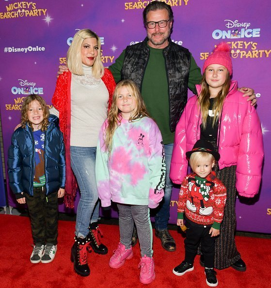 "Finn Davey McDermott, Tori Spelling, Hattie Margaret McDermott, Dean McDermott, Beau Dean McDermott, and Stella Doreen McDermott attend 2019 Disney On Ice ""Mickey's Search Party"" on December 13, 2019 