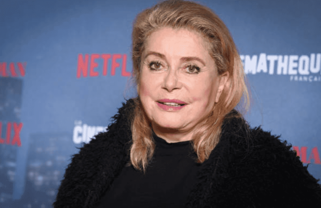 "Catherine Deneuve poses on the red carpet at the  premiere for ""The Irishman,"" on October 17, 2019 in Paris, France 