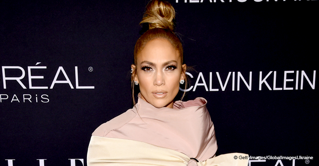 Jennifer Lopez Flashes Her Sparkling Hips in a Barely-There Dress Laying Atop of a Piano