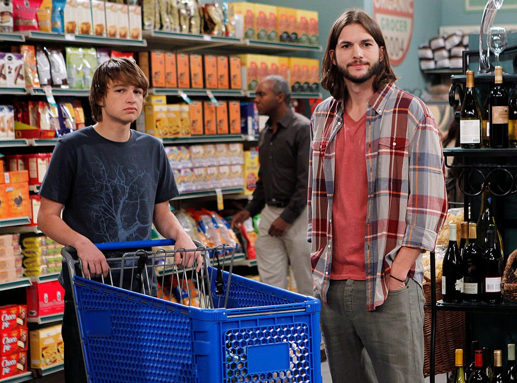 Jake (Angus T. Jones) and Walden Schmidt (Ashton Kutcher) on TWO AND A HALF MEN, Monday, Nov. 21 2011.   Source: Getty Images