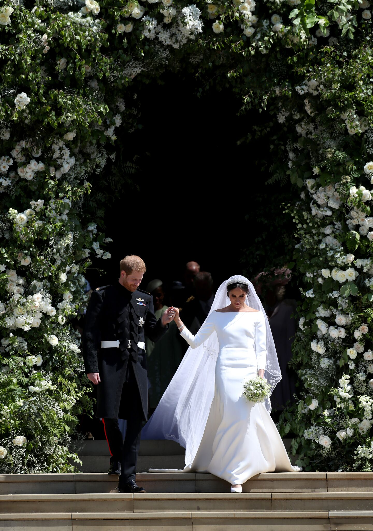 Meghan Markle and Prince Harry surrounded by flowers on their wedding day | Getty Images / Global Images Ukraine