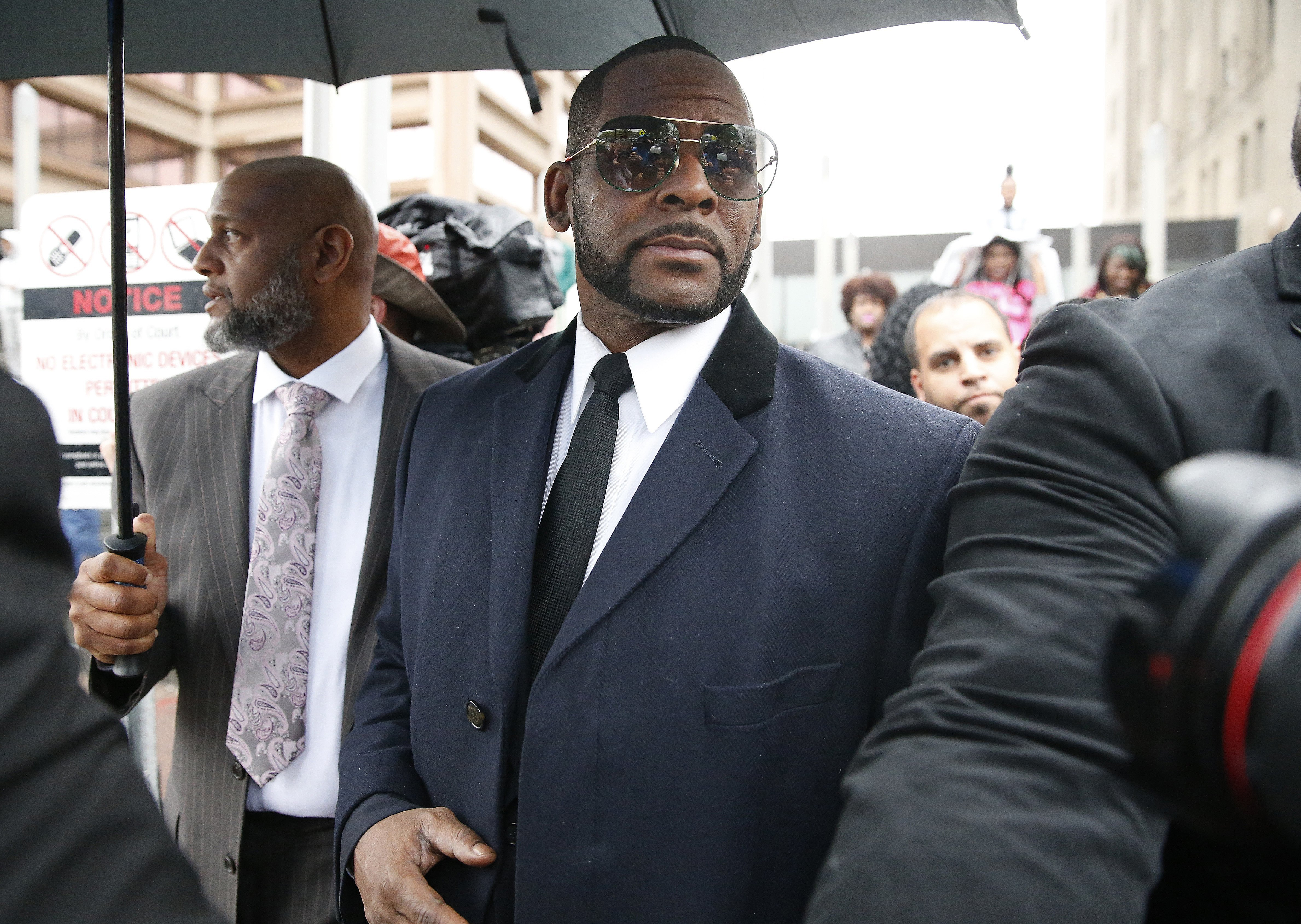 R. Kelly leaging a courthouse in Chicago after a status hearing for sexual abuse allegations in May 2019.