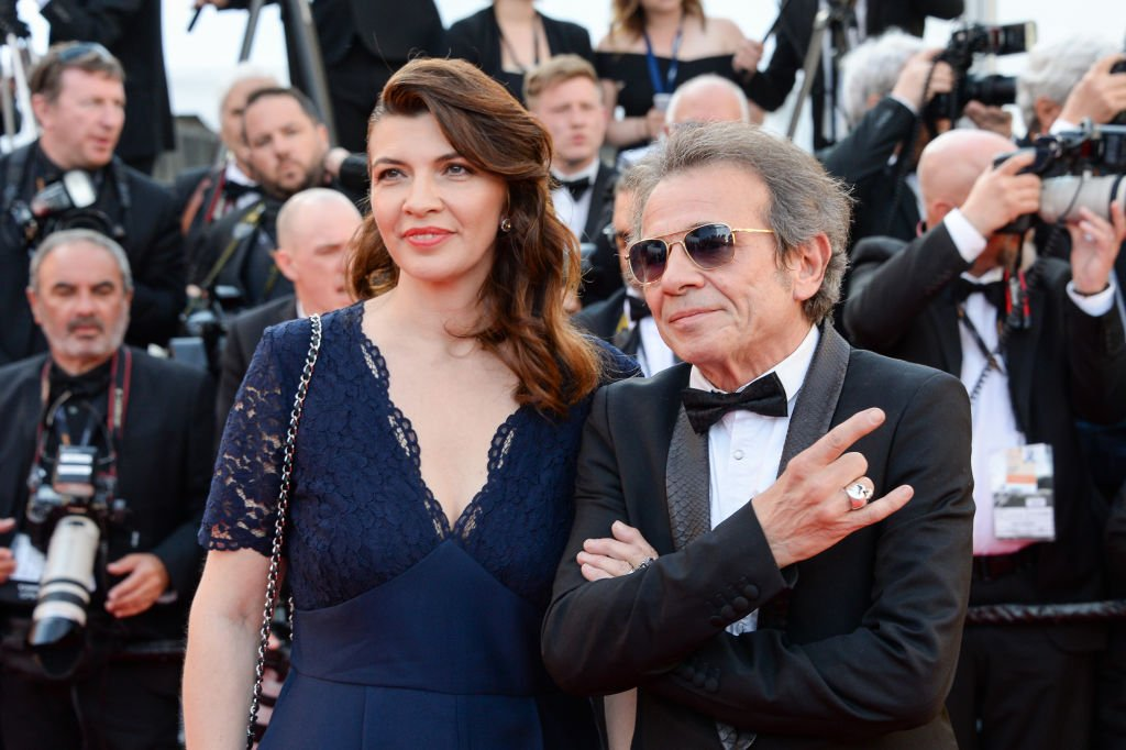 "Philippe Manœuvre et son épouse Candice de la Richardière assistent à la projection de ""Les Misérables"" lors de la 72ème édition du Festival de Cannes le 15 mai 2019 à Cannes, France. 